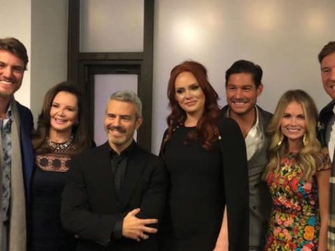 andy cohen stands with the southern charm cast