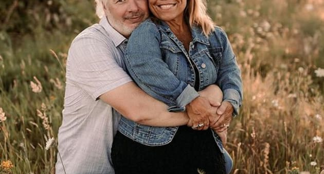 amy roloff and chris marek in a meadow